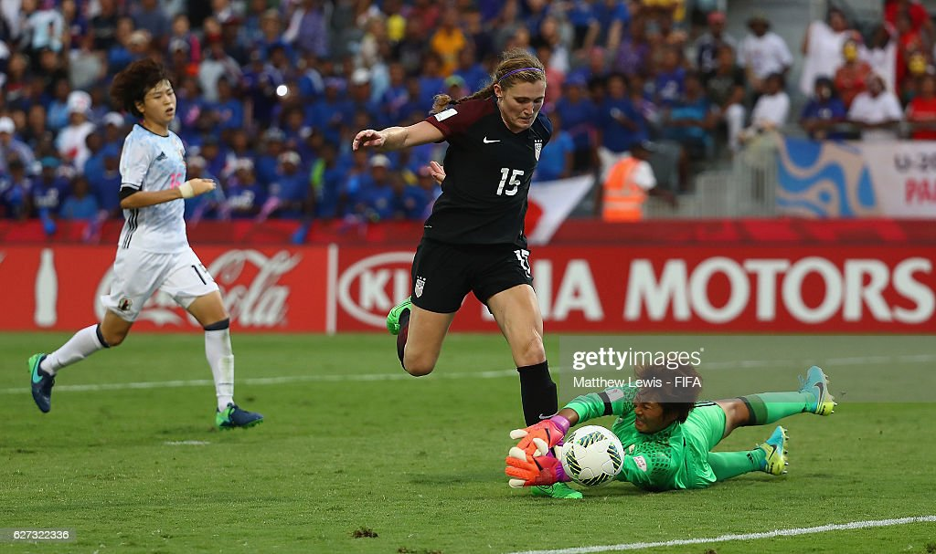 Jessie Scarpa of the United States looks to beat Chika Hirao of Japan during the FIFA U-20 Women's World Cup Papua New Guinea 2016 Third Place Play Off match between USA and Japan at the National Football Stadium on December 3, 2016 in Port Moresby, Papua New Guinea.