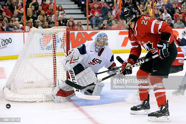 Jessie Vetter of Team USA stops the puck on a shot by Natalie Spooner of Team Canada during the IIHF Womens World Championship Gold Medal Game at...