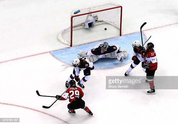 Jessie Vetter of the United States gives up a goal in overtime to Marie-Philip Poulin of Canada during the Ice Hockey Women's Gold Medal Game on day...
