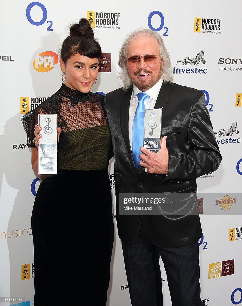 Jessie Ware and Barry Gibb attend the Nordoff Robbins Silver Clef Awards at London Hilton on June 28, 2013 in London, England.