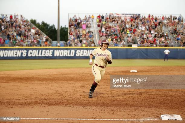 Jessie Warren of the Florida State Seminoles celebrates after a home run against the Washington Huskies during the Division I Women's Softball...