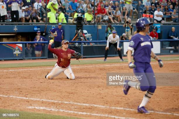 Jessie Warren of the Florida State Seminoles makes a diving catch and doubles up a runner on first against the Washington Huskies during the Division...