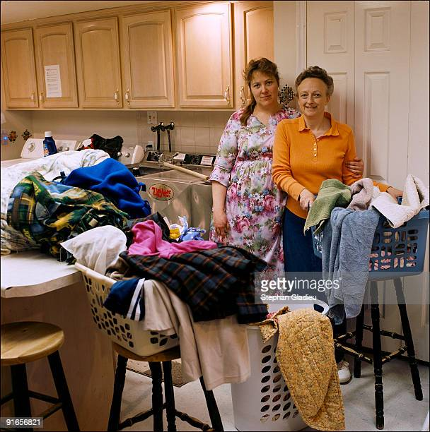 Jessikah and Joyce two sisterwives from the small polygamist community of Centennial Park at the border of Utah and Arizona are doing laundry for...