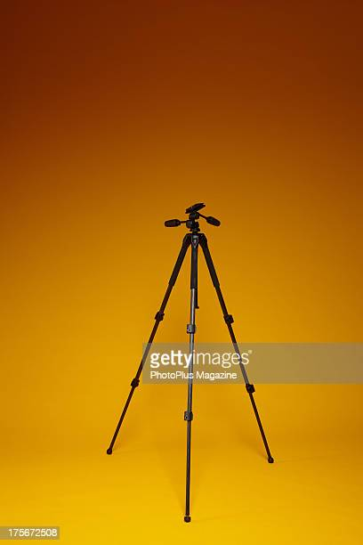 A Jessops Major Carbon Fibre tripod photographed on a yellow background for a feature on budget photography accessories taken on January 4 2013