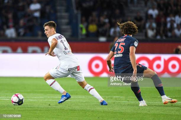 Jessy Deminguet of Caen and Adrien Rabiot of PSG during the French Ligue 1 match between Paris Saint Germain and Caen at Parc des Princes on August...