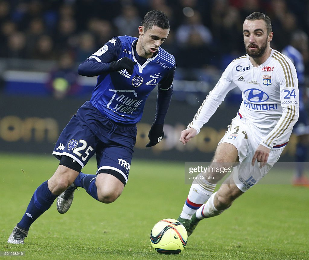 Jessy Pi of Troyes and Sergi Darder of Lyon in action during the French Ligue 1 match between Olympique Lyonnais (OL) and Troyes ESTAC at their brand new stadium, Parc Olympique Lyonnais on January 9, 2016 in Lyon, France.