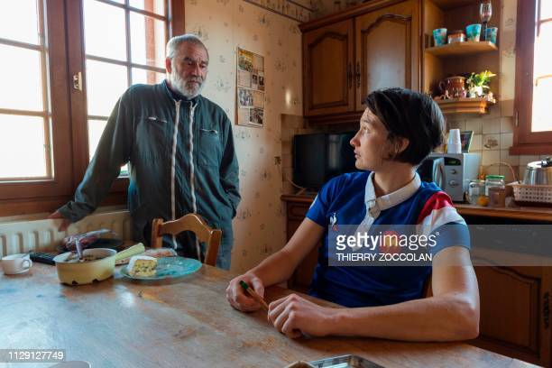 Jessy Tremouliere French rugby player and winner of the last World Rugby Women's 15s Player of the Year award talks with a relative in her organic...