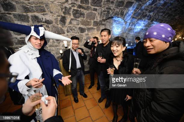 A jester performs a magic trick at the Excalibur Dinner hosted by Roger Dubuis during the 23rd Salon International de la Haute Horlogerie at Caves...
