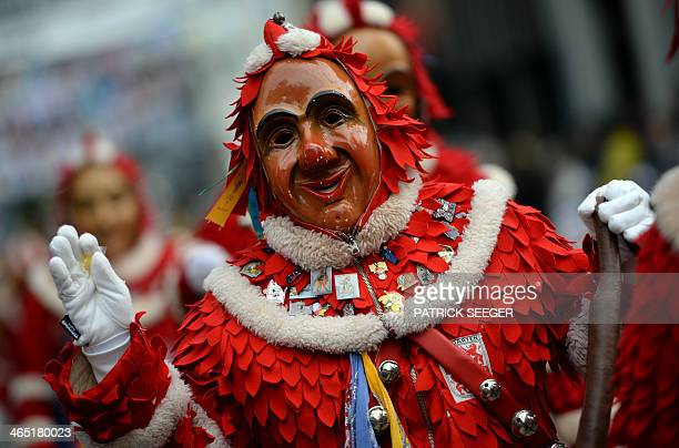 A jester takes part in a parade during the meeting of jester guilds in Hausach southern Germany on January 26 2014 The 'SwabianAlemannic' Carnival...