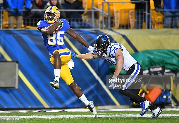 Jester Weah of the Pittsburgh Panthers avoids a tackle by Corbin McCarthy of the Duke Blue Devils during the third quarter at Heinz Field on November...