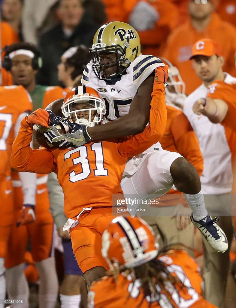 Jester Weah #85 of the Pittsburgh Panthers goes up for a ball against Ryan Carter #31 of the Clemson Tigers during their game at Memorial Stadium on November 12, 2016 in Clemson, South Carolina.