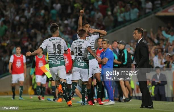 Jesu Isijara of Santos celebrates with teammates after scoring the first goal of his team during the 9th round match between Santos Laguna and Cruz...