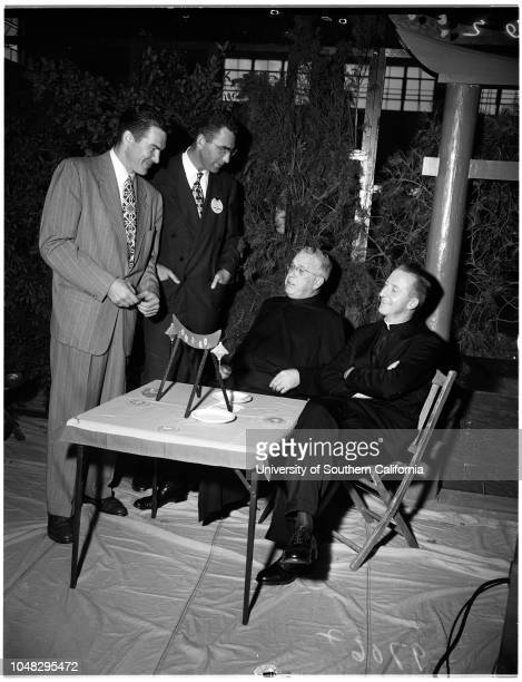 Jesuit priest at Loyola 28 September 1952 Jess IversJune HaverReverend William D RyanMrs Frank LovejoyCaption slip reads 'Photographer Sandusky Date...