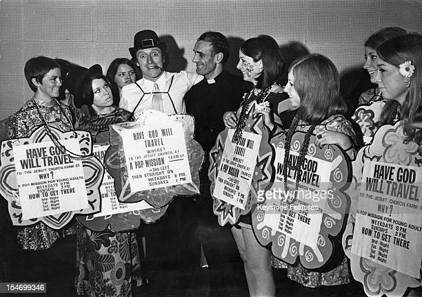 Jesuit priest Father George Giarchi with English dj and television presenter Jimmy Savile and a group of 'flower girls' at a runthrough for a...