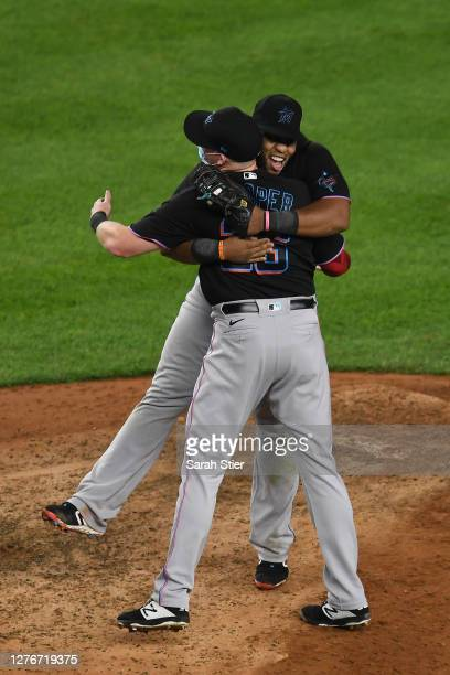 Jesus Aguilar celebrates with Garrett Cooper of the Miami Marlins during the tenth inning against the New York Yankees at Yankee Stadium on September...