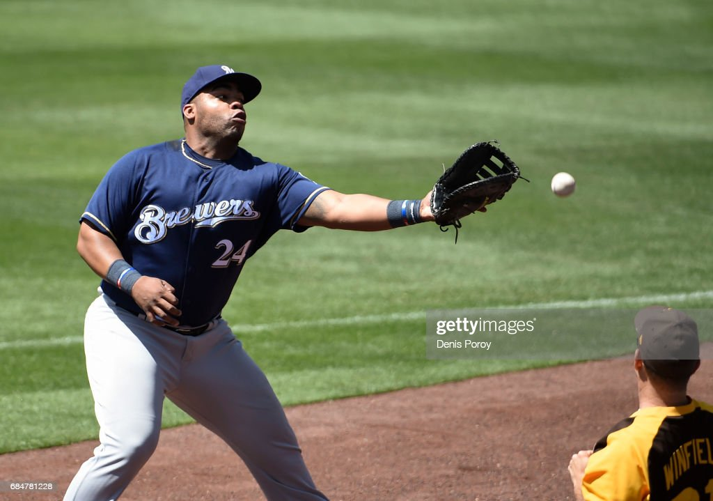 Jesus Aguilar #24 of the Milwaukee Brewers can't make the catch on a foul ball off the bat of Luis Torrens of the San Diego Padres during the seventh inning of a baseball game at PETCO Park on May 18, 2017 in San Diego, California.