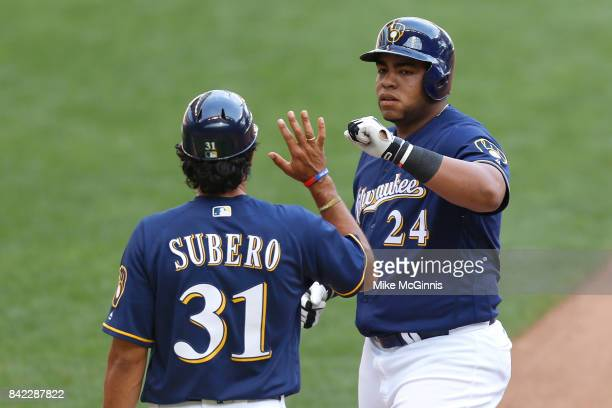 Jesus Aguilar of the Milwaukee Brewers celebrates after hitting a single during the seventh inning against the Washington Nationals at Miller Park on...