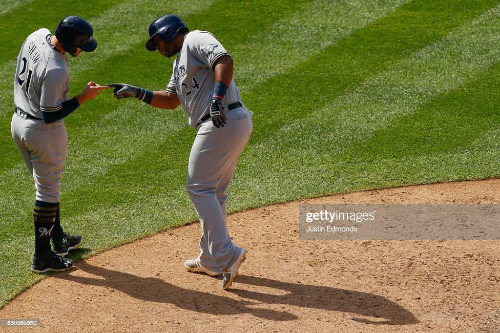 Jesus Aguilar #24 of the Milwaukee Brewers celebrates his two-run home run with Travis Shaw #21 during the seventh inning during the game against the Colorado Rockies at Coors Field on August 20, 2017 in Denver, Colorado.