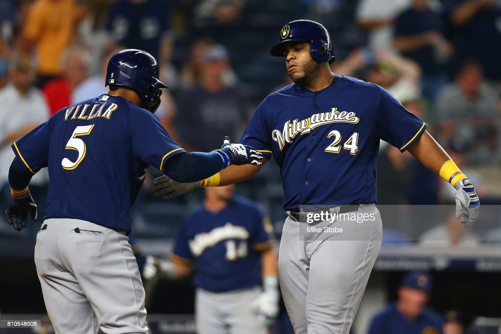 Jesus Aguilar #24 of the Milwaukee Brewers celebrates with Jonathan Villar #5 after hitting a grand slam in the seventh inning against the New York Yankees at Yankee Stadium on July 7, 2017 in the Bronx borough of New York City.