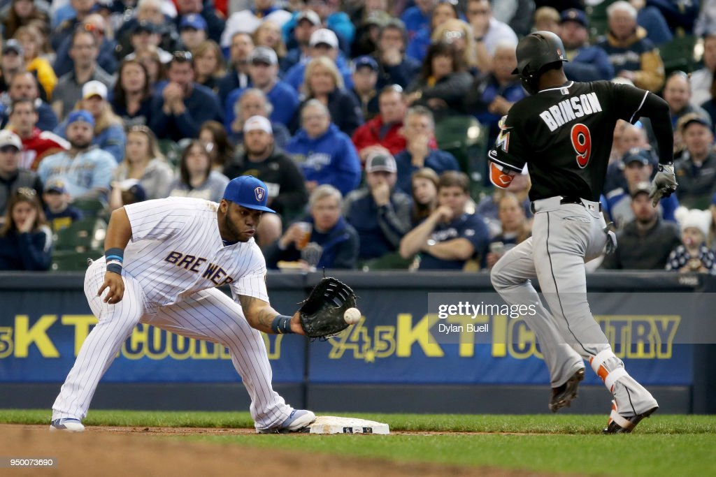 Jesus Aguilar #24 of the Milwaukee Brewers forces out Lewis Brinson #9 of the Miami Marlins at first base in the fourth inning at Miller Park on April 22, 2018 in Milwaukee, Wisconsin.