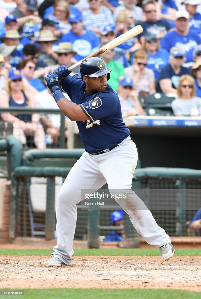 Jesus Aguilar #24 of the Milwaukee Brewers gets ready in the batters box during the fifth inning of a spring training game against the Kansas City Royals at Surprise Stadium on March 7, 2018 in Surprise, Arizona.