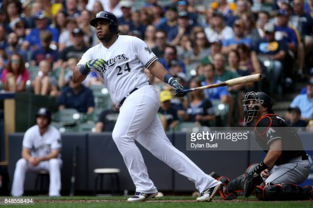 Jesus Aguilar of the Milwaukee Brewers hits a double in the fourth inning against the Miami Marlins at Miller Park on September 17 2017 in Milwaukee...