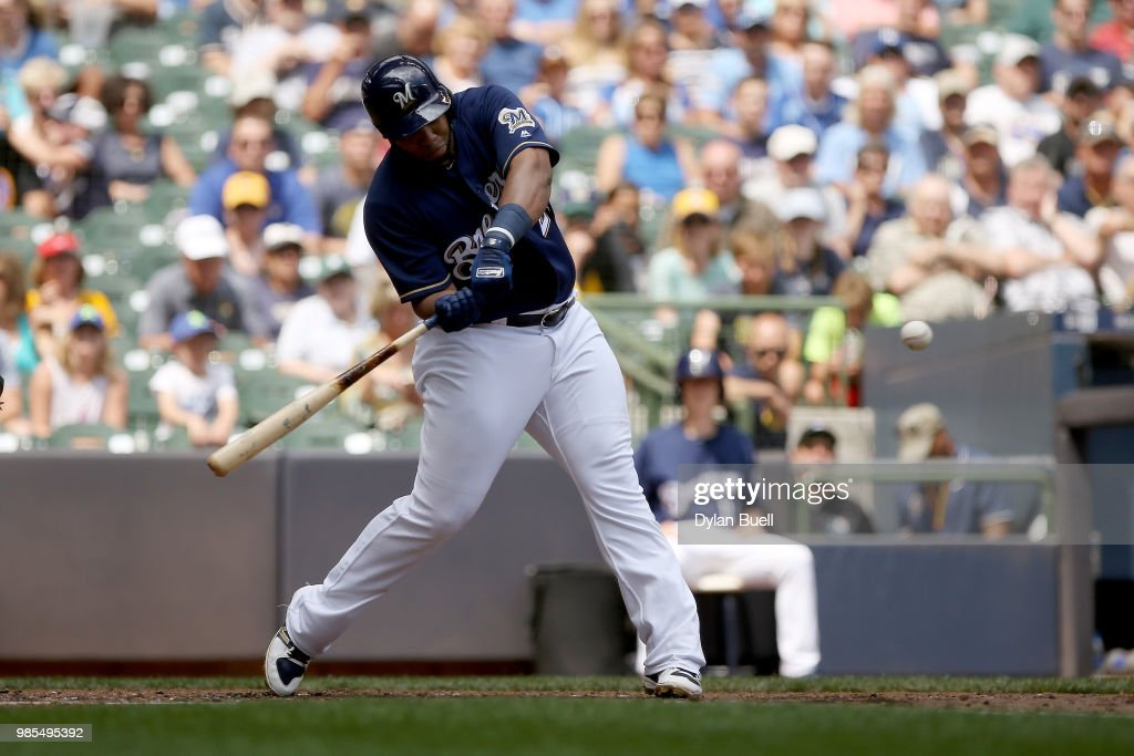 Jesus Aguilar #24 of the Milwaukee Brewers hits a home run in the sixth inning against the Kansas City Royals at Miller Park on June 27, 2018 in Milwaukee, Wisconsin.