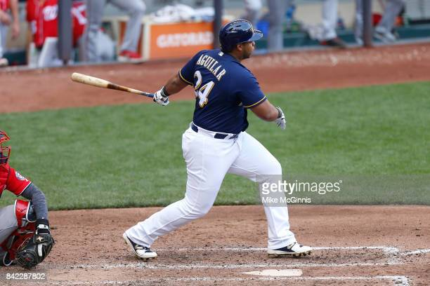 Jesus Aguilar of the Milwaukee Brewers hits a single during the seventh inning against the Washington Nationals at Miller Park on September 03 2017...