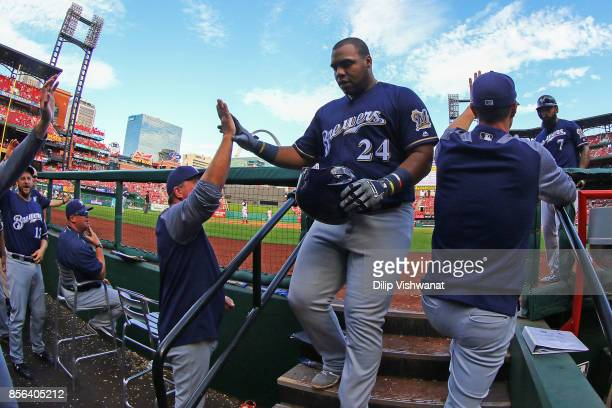 Jesus Aguilar of the Milwaukee Brewers is congratulated by teammates after hitting a tworun home run against the St Louis Cardinals in the eighth...