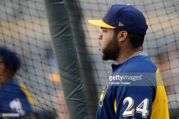 Jesus Aguilar of the Milwaukee Brewers looks on during batting practice before the game against the Minnesota Twins on August 7 2017 at Target Field...