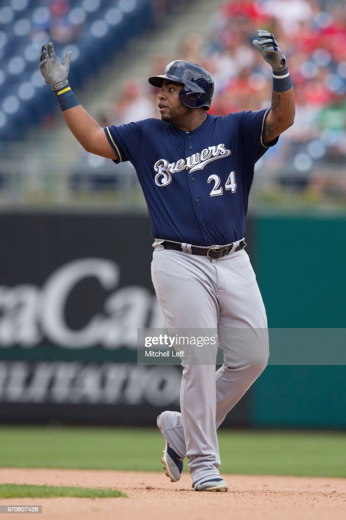 Jesus Aguilar #24 of the Milwaukee Brewers reacts after hitting an RBI double in the top of the seventh inning against the Philadelphia Phillies at Citizens Bank Park on June 9, 2018 in Philadelphia, Pennsylvania. The Brewers defeated the Phillies 12-3.
