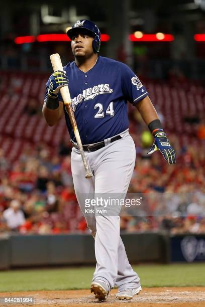 Jesus Aguilar of the Milwaukee Brewers reacts after striking out during the game against the Cincinnati Reds at Great American Ball Park on September...
