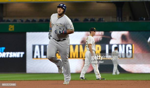 Jesus Aguilar of the Milwaukee Brewers rounds the bases after hitting a solo home run in the second inning during the game against the Pittsburgh...