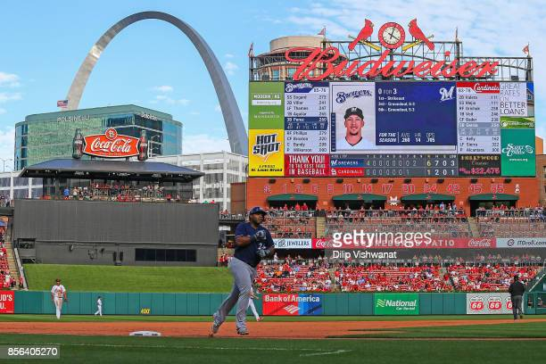 Jesus Aguilar of the Milwaukee Brewers rounds third base after hitting a tworun home run against the St Louis Cardinals in the eighth inning at Busch...