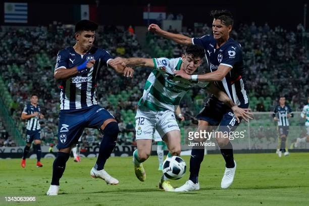 Jesus Alberto Ocejo of Santos fights for the ball with Jesus Gallardo and Hector Moreno of Monterrey during the 10th round match between Santos...