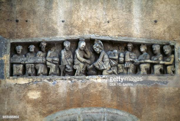 Jesus and the washing of the feet 12th century relief in Rue des Gras ClermontFerrand AuvergneRhoneAlpes France