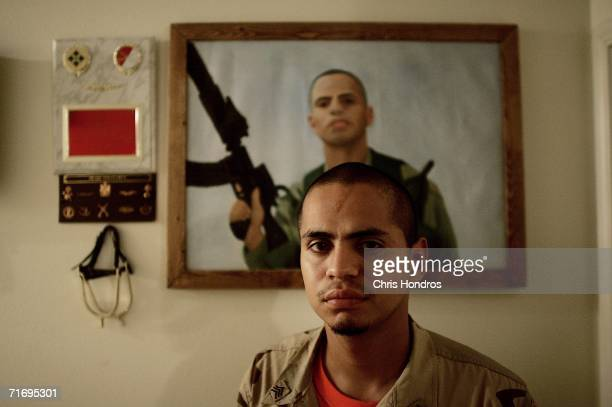 Jesus Bocanegra stands in front a painting of himself done while he was serving in Iraq May 27 2006 in McAllen Texas Bocanegra has been diagnosed...