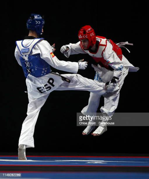 Jesus Cabrera Tortosa of Spain and Gashim Magomedov of Azerbaijan during their round 16 match of the Men's 58kg division at The World Taekwondo...