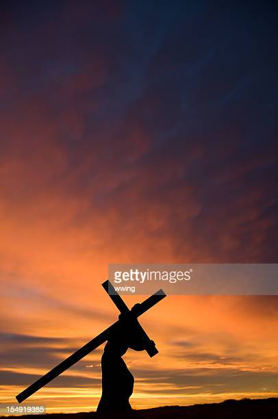 Jesus Carrying the Cross with Orange Sunset ... Vertical