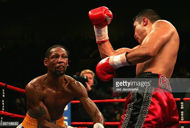Jesus Chavez throws a right as Leavander Johnson is knocked back during the IBF Lightweight World Title Bout at the MGM Grand Garden Arena on...