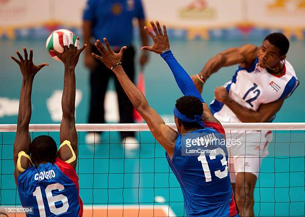 Jesus Chourio and Ivan Marquez of Venenzuela and Bell Cisnero Henry during the men's volleyball in the 2011 XVI Pan American Games at Pan American...