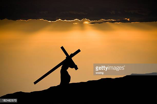 jesus christ carrying the cross - good friday stock pictures, royalty-free photos & images
