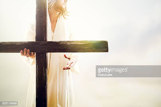 jesus christ holding cross - the crucifixion stock pictures, royalty-free photos & images