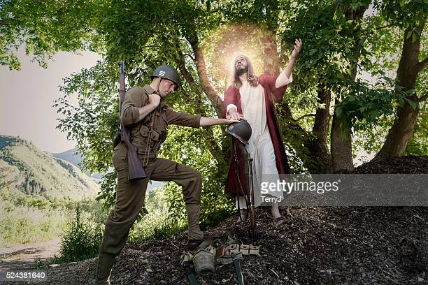 jesus christ look up while a soldier prays - soldier praying stock photos and pictures