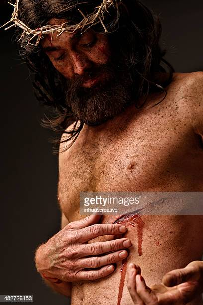 jesus christ looking at wounds - happy easter jesus stock photos and pictures