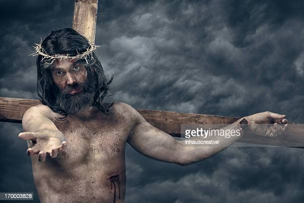 jesus christ on cross reach out - jesus blood stock pictures, royalty-free photos & images