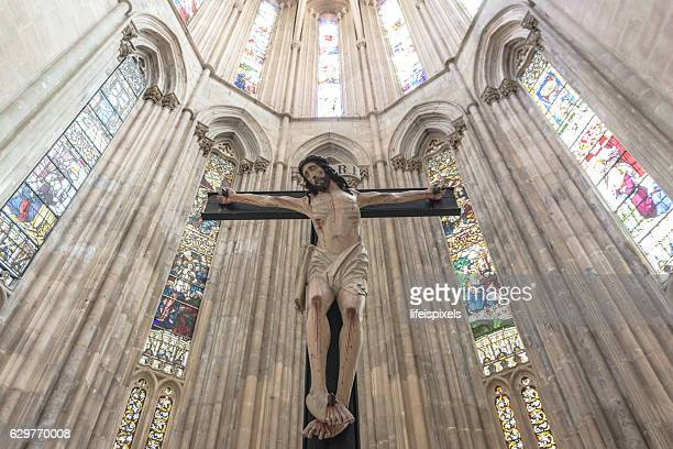 jesus christ on the cross inside batalha monastery, portugal - lifeispixels stock pictures, royalty-free photos & images
