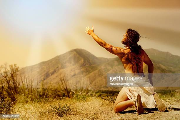 Jesus Christ reaching out to heaven.