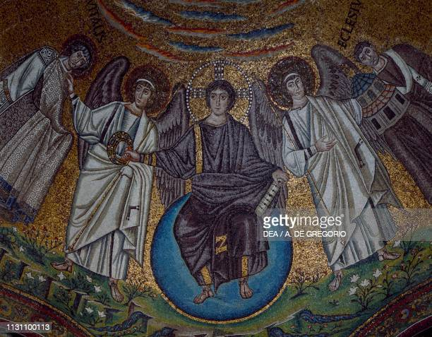 Jesus Christ sitting on a globe with Archangels Michael and Gabriel gives a crown to Saint Vitale apse mosaic of the Basilica of San Vitale Ravenna...