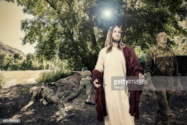 jesus christ takes the soul of dead soldier to heaven - dead soldier stock photos and pictures